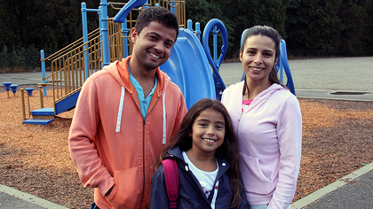Family near the playground on the first day of school