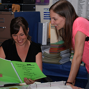 Two staff members working together in classroom