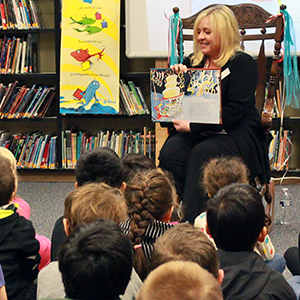 Superintendent reads to a group of elementary school students