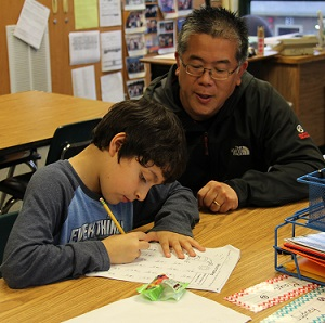 Community volunteer works with elementary school student