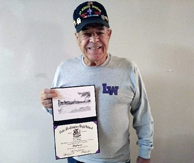 Veteran Larry Barker with his LWHS diploma.