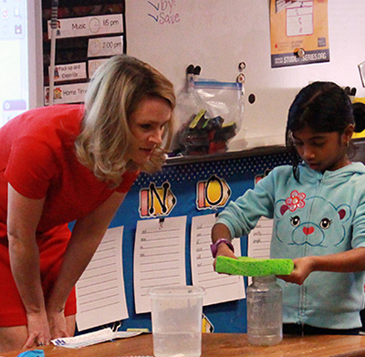 Shannon O'Donnell performs weather experiments with Dickinson first-graders