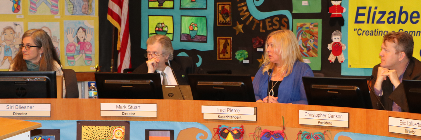 Four board members listen during a board meeting