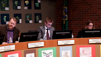 Three school board members during a board meeting