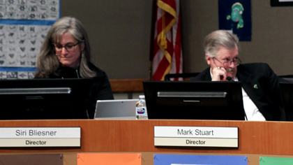 Two school board members during a board meeting