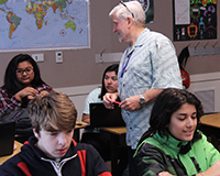 Substitute teacher talking with her students.