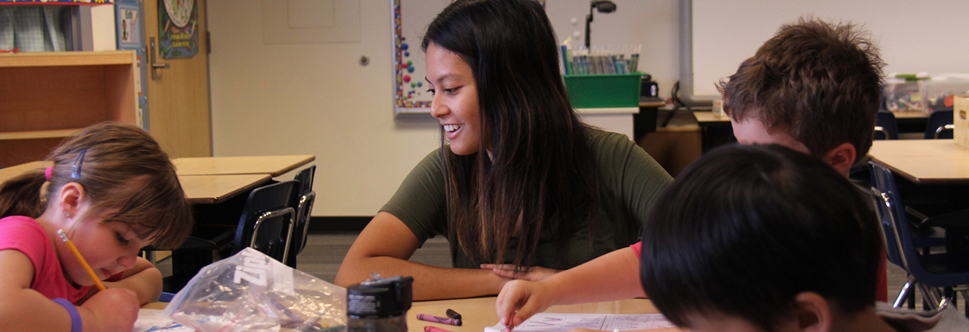 Elementary teacher smiling at her students.