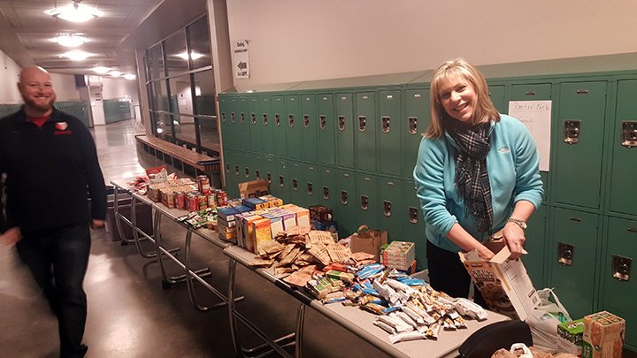 Staff at Redmond Middle School making Pantry Packs for food-insecure students.