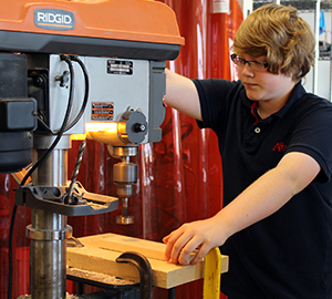 LWHS student drills through wood in Materials Science class