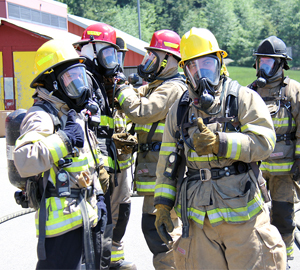 WANIC students in Fire Fighting program in full fire fighing gear