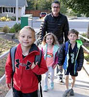 Three Bell Elementar students walk to school with their dad