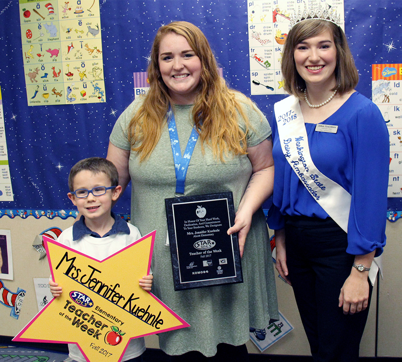 Alcott teacher and STAR 101.5 Teacher of the Week, Jennifer Kuehnle, with the student who nominated her and the Washington State Dairy Ambassador.