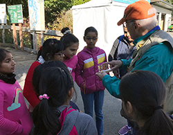 Dickinson fourth grade students learn from an employee of the Issaquah Salmon Hatchery