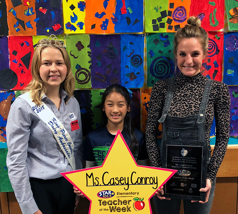 STAR 101.5 Teacher of the Week, Casey Conroy, with the student who nominated her and the King-Pierce Counties Dairy Ambassador