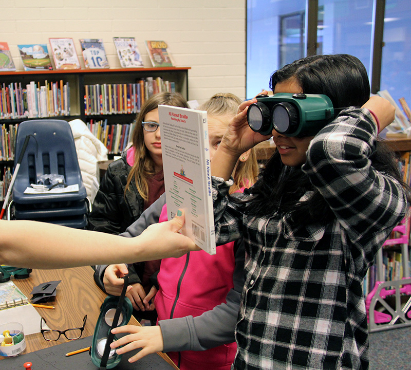 Mead students experience reading with a simulated vision disability