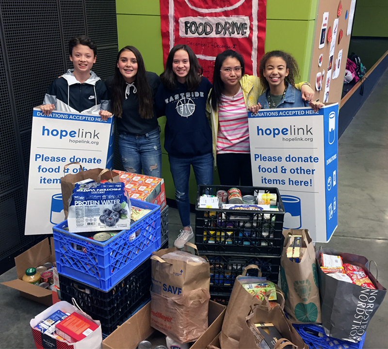 Five Rose Hill Middle School students with food drive donations