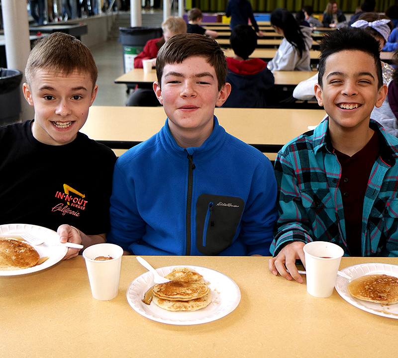 Finn Hill student scholars enjoy pancake breakfast from their teachers