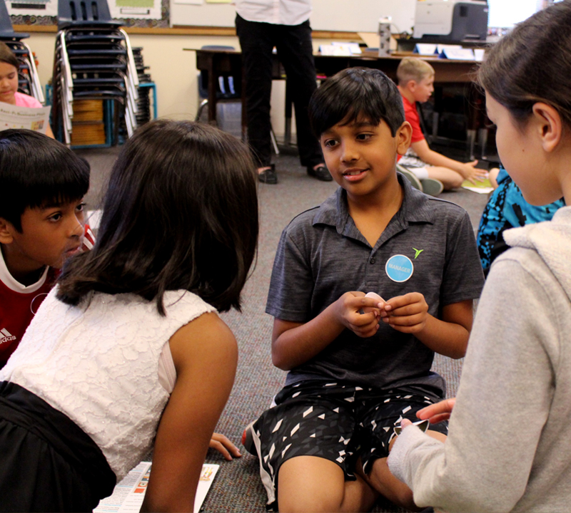 Volunteers teach third-graders how their city works