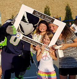 Seahawks mascot, Blitz, with students