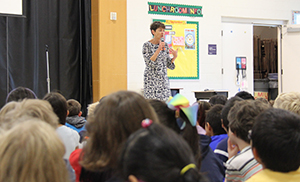 Author Annie Barrows presenting to students