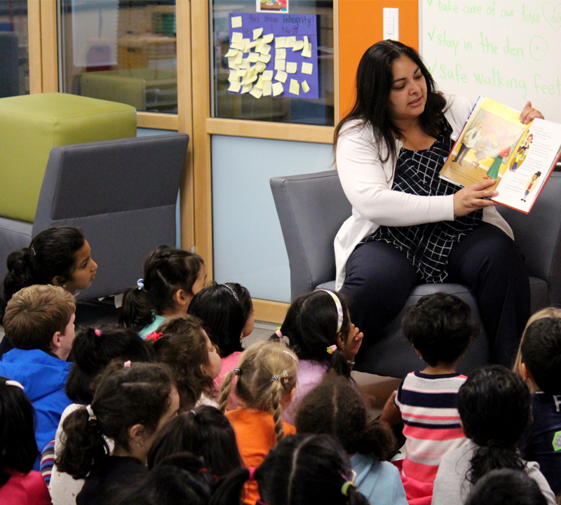 Senator Manka Dhingra reads to students