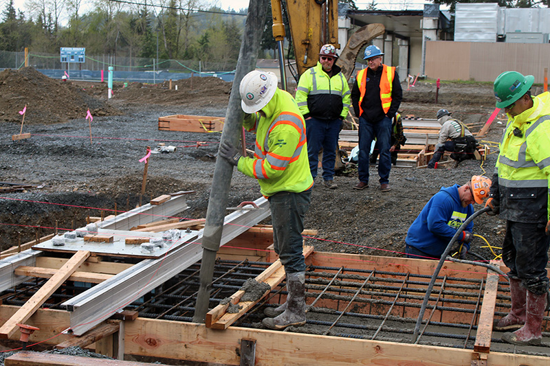 Concrete for foundation footings poured at Juanita High School