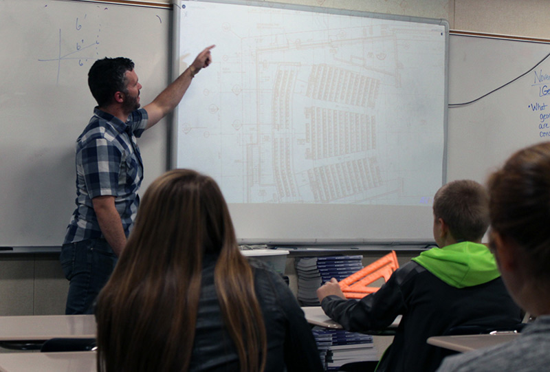 Students looking at blueprint on screen