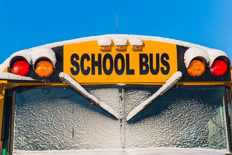 snow-covered school bus