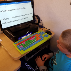 Elementary student works on assistive technology computer