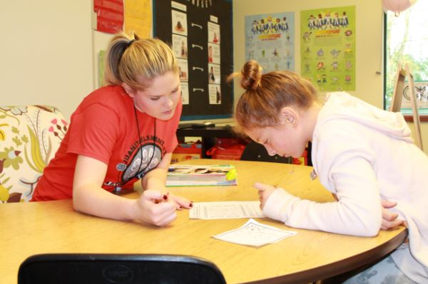 Teacher working with a student.