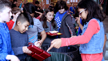 Students separating food waste, garbage and recycleables after lunch