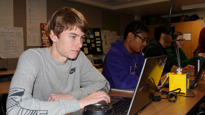 High school students working on laptops