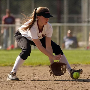 Eastlake High School fastpitch softball player fields the ball during a game