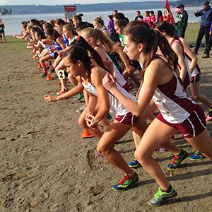 Eastlake High School Cross Country team at start of race on sand
