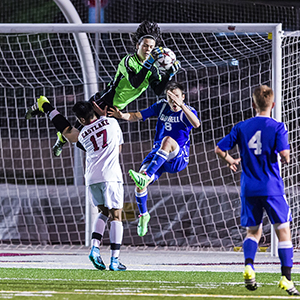 Eastlake High School goalie catches soccer ball during match