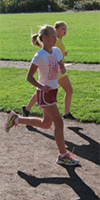 Two Finn Hill Middle School girls run during track practice