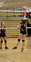 Kamiakin Middle School volleyball player hits the ball over the net