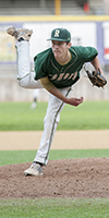 Redmond High School baseball player pitches during a game