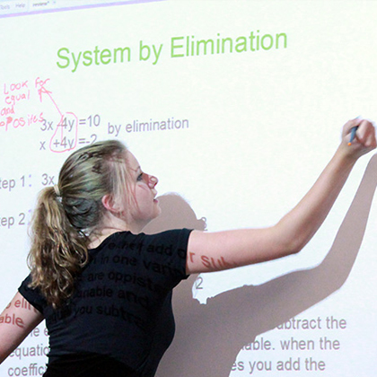 Student solves equation during Algebra Prep Summer School